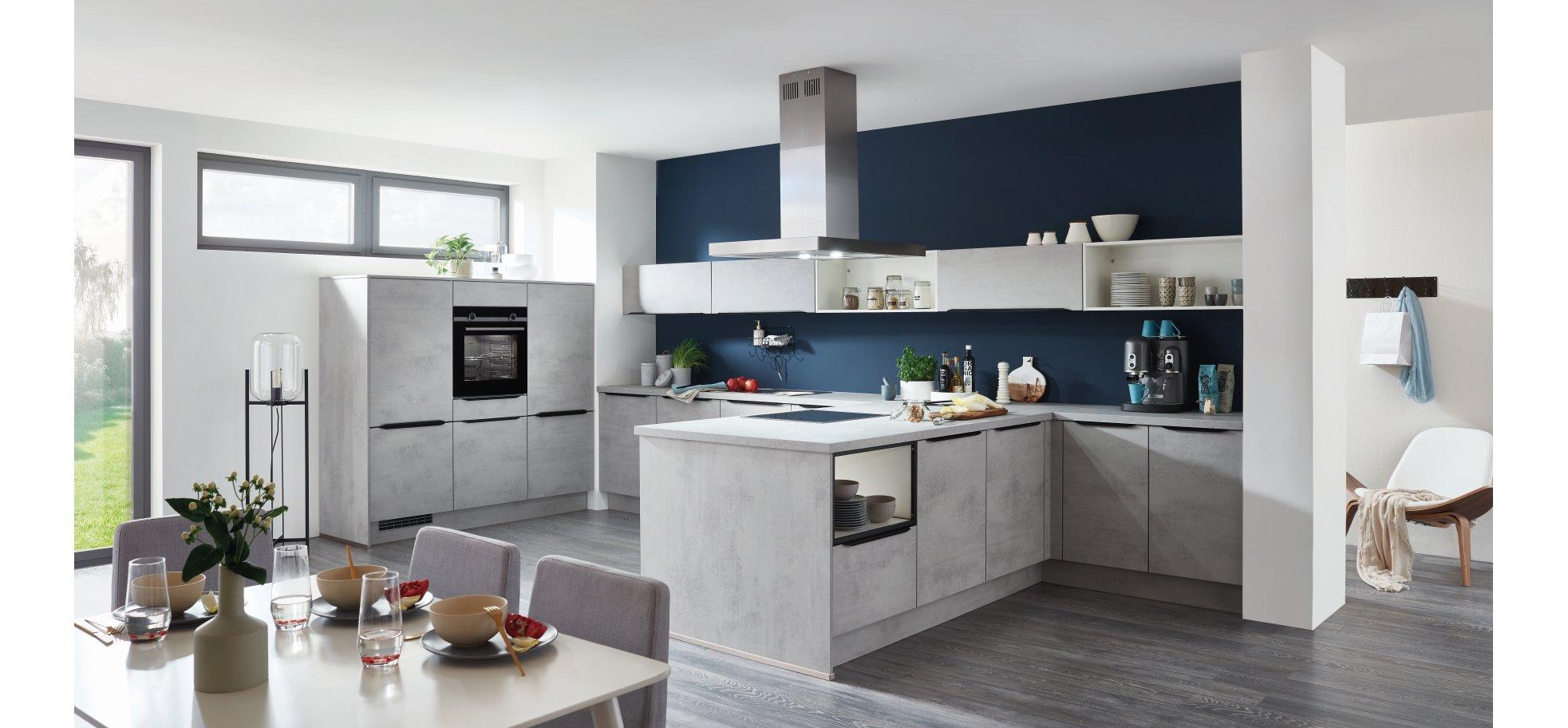 Eine Küche mit Klasse in Beton grau Nachbildung mit hochwertiger  Markentechnik von Siemens